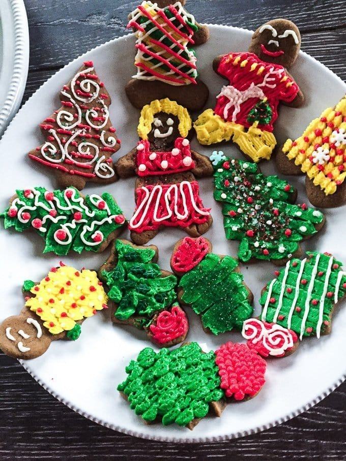 Frosted Gingerbread Cookies - soft and chewy with colorful buttercream frosting wwww.sweetcayenne.com