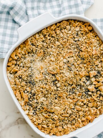 Baked poppy seed chicken casserole in a white baking dish.