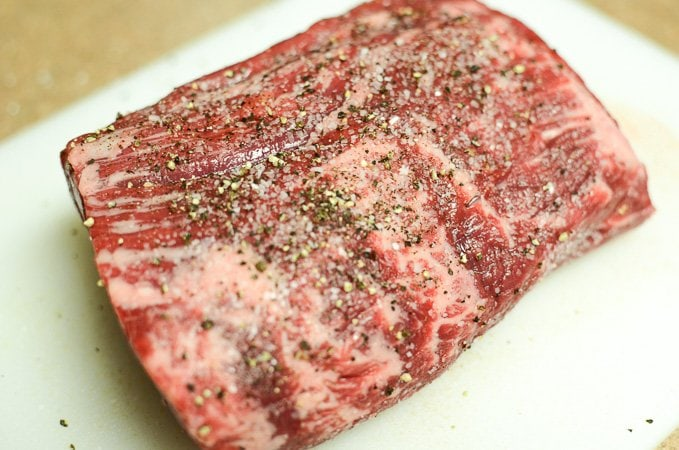 Season the meat liberally with coarse Kosher salt and freshly cracked black pepper.