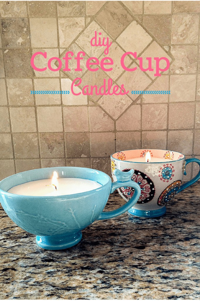 "Two lit Coffee Cup Candles sitting on a marble kitchen counter top with, ""DIY Coffee Cup Candles"" displayed above the candles."