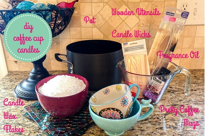 DIY Coffee Cup Candle supplies on a kitchen counter top. Pink text descriptors are over each corresponding supply item.
