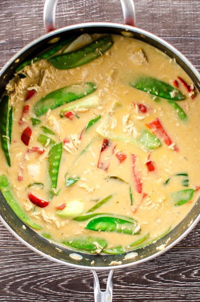 A pan of green curry soup.