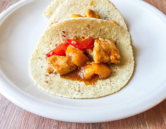 An open faced mango chicken taco.