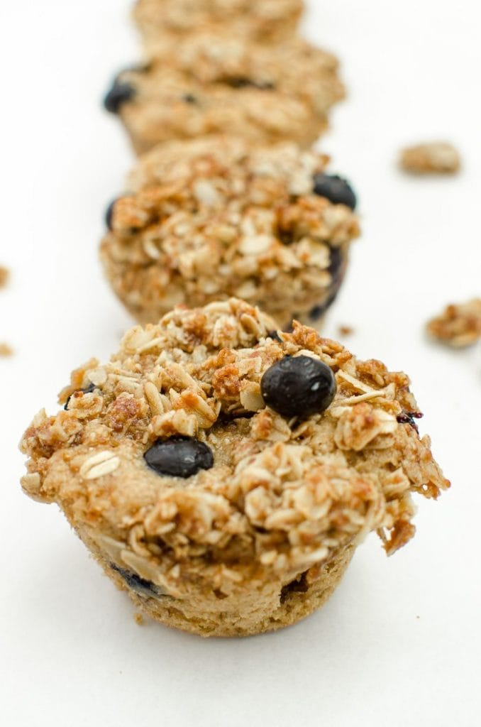 Lightened up blueberry muffins are naturally-sweetened and topped with a toasted, honeyed oat streusel.