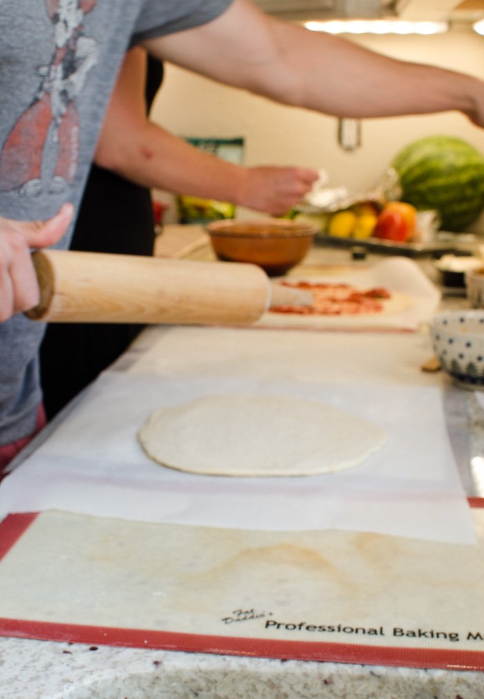 Rolling dough for a pizza party,