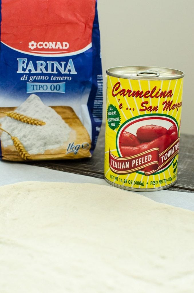 Authentic Italian ingredients for a pizza party - double zero flour and San Marzano tomatoes