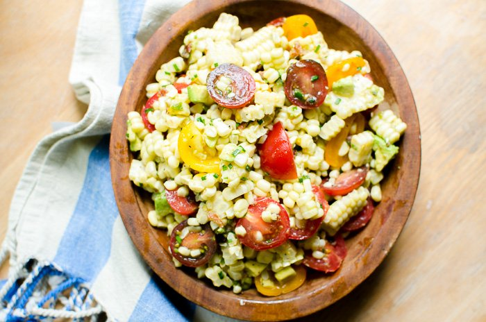 This summer salad is full of freshly-picked veggies from your garden - starting with juicy tomatoes and sweet corn! Perfect for a picnic or cookout!