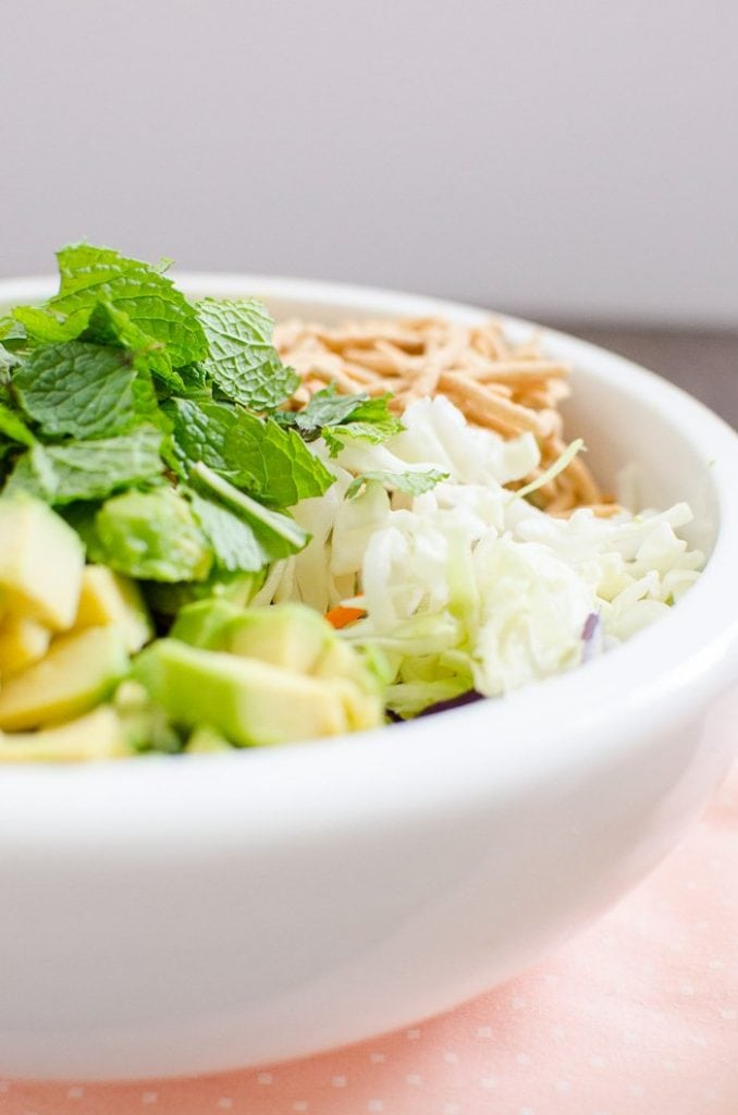 A close up view of awhite bowl with Chow Mein Chopped Salad.