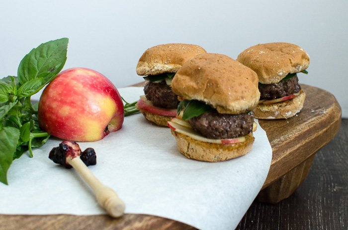 Blackberry Basil Sliders are fun summer to fall transition burger that joins the flavor of fresh summer herbs and preserves with fall apples. Try them for Labor Day or your next tailgate!