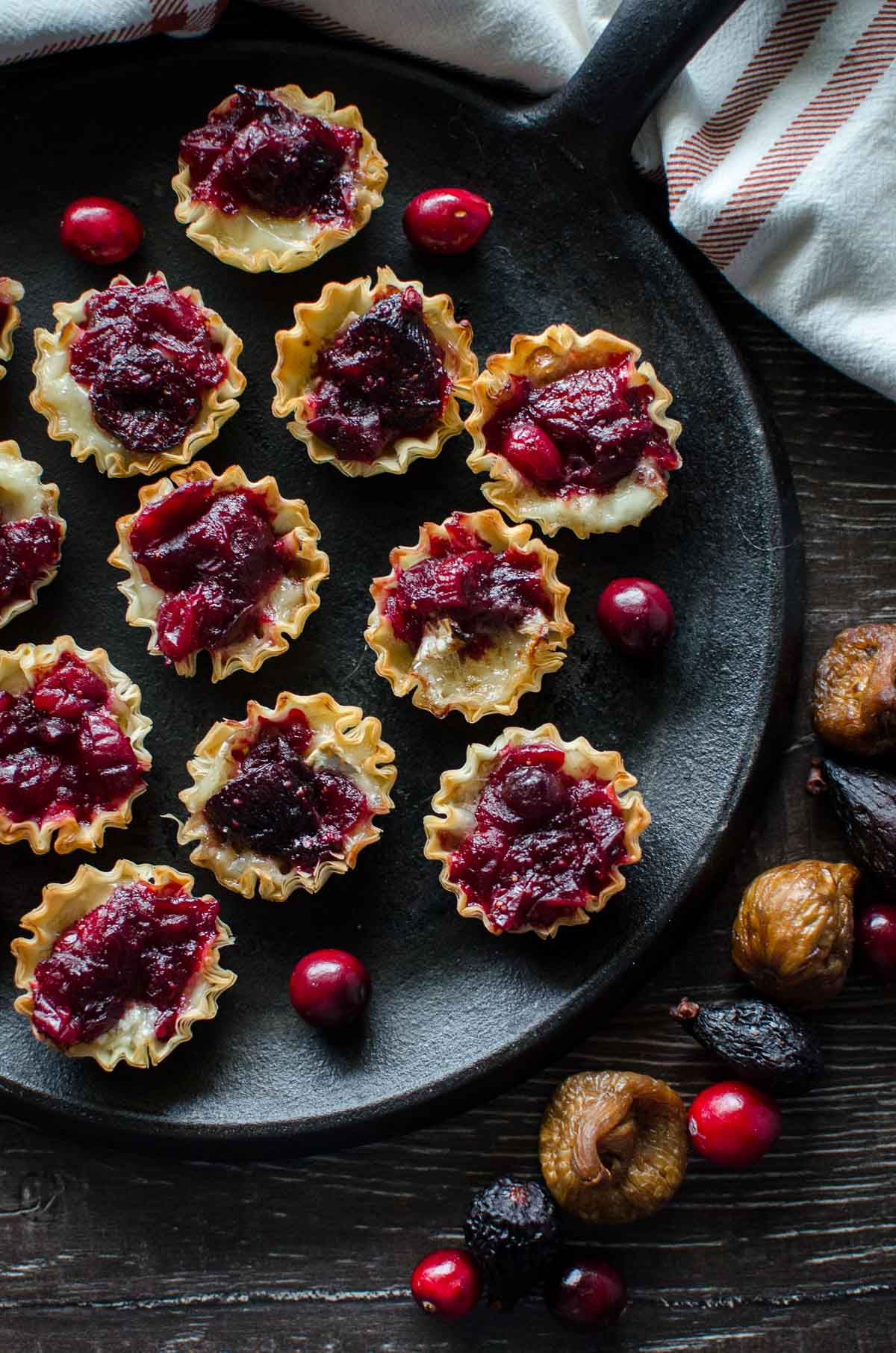 These Fig and Cranberry Brie Tarlets are SO easy to make and are perfect for a stunning, portion-controlled holiday party appetizer!