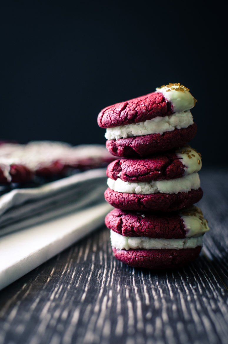 Red Velvet Sandwich Cookies are so easy to make and a great way to use a box of cake mix for a purpose other than cake! There's so many fun flavor combinations you can make with this basic recipe.