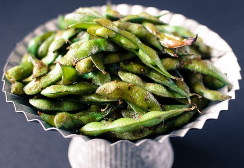 Roasted Edamame with Togarashi and Smoked Sea Salt is an easy appetizer with only 5 ingredients that comes together in under 15 minutes! It's gluten free, low calorie, and mind-blowingly delicious!