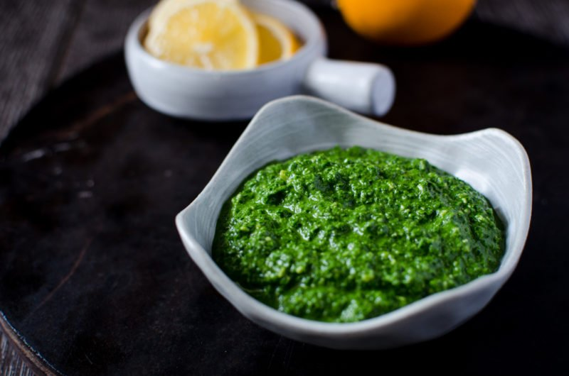 Kale Pesto is an easy, fresh condiment you can make at home that adds a bright cheery flavor to pastas, salad, sandwiches, dips and soups!