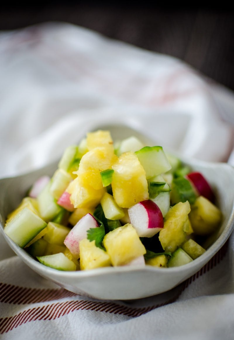 A bright and colorful pineapple salsa adds the perfect touch to fish taco bowls and is filled with spring produce like pineapple, cucumber, and radishes.