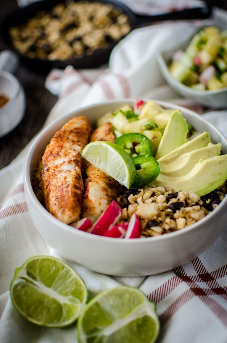 "If you like ""bowl food,"" you'll love this fresh and flavorful taco bowls with spicy pan-seared fish, plantain fried rice, black beans, and a juicy pineapple salsa! A fun take on an easy fish taco recipe."