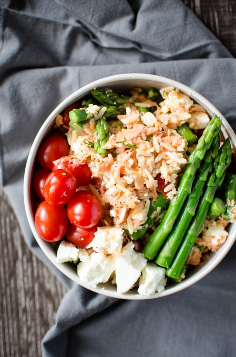 This simple salad recipe can be ready in 30 minutes and is bursting with fresh spring flavor. Use garden-fresh asparagus, tiny grape tomatoes, fresh dill, lemon, and perfectly roasted salmon!