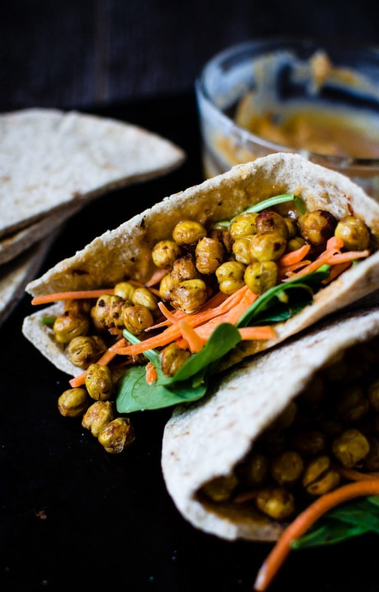 These pitas are stuffed to the brim with a powerful fusion of Middle Eastern and Asian flavors. Hot and crispy roasted chickpeas are the star and a creamy miso tahini sauce brings everything together. SO easy to make and is wonderful for lunch!