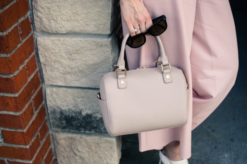Blush pink culottes paired with a cropped black shell and Sam Edelman heels with a nude bag and necklace. Elegant spring outfit idea!