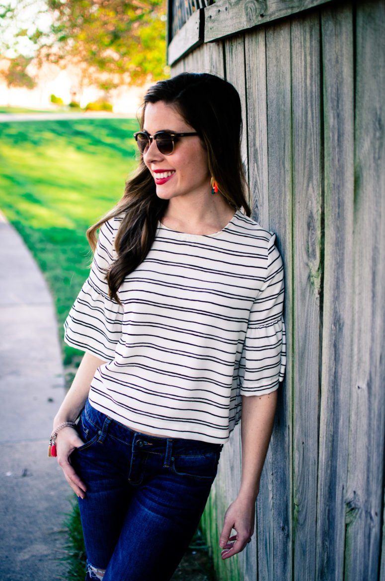 Cropped striped blouse from Who What Wear collection at Target with distressed denim and tassel jewelry.