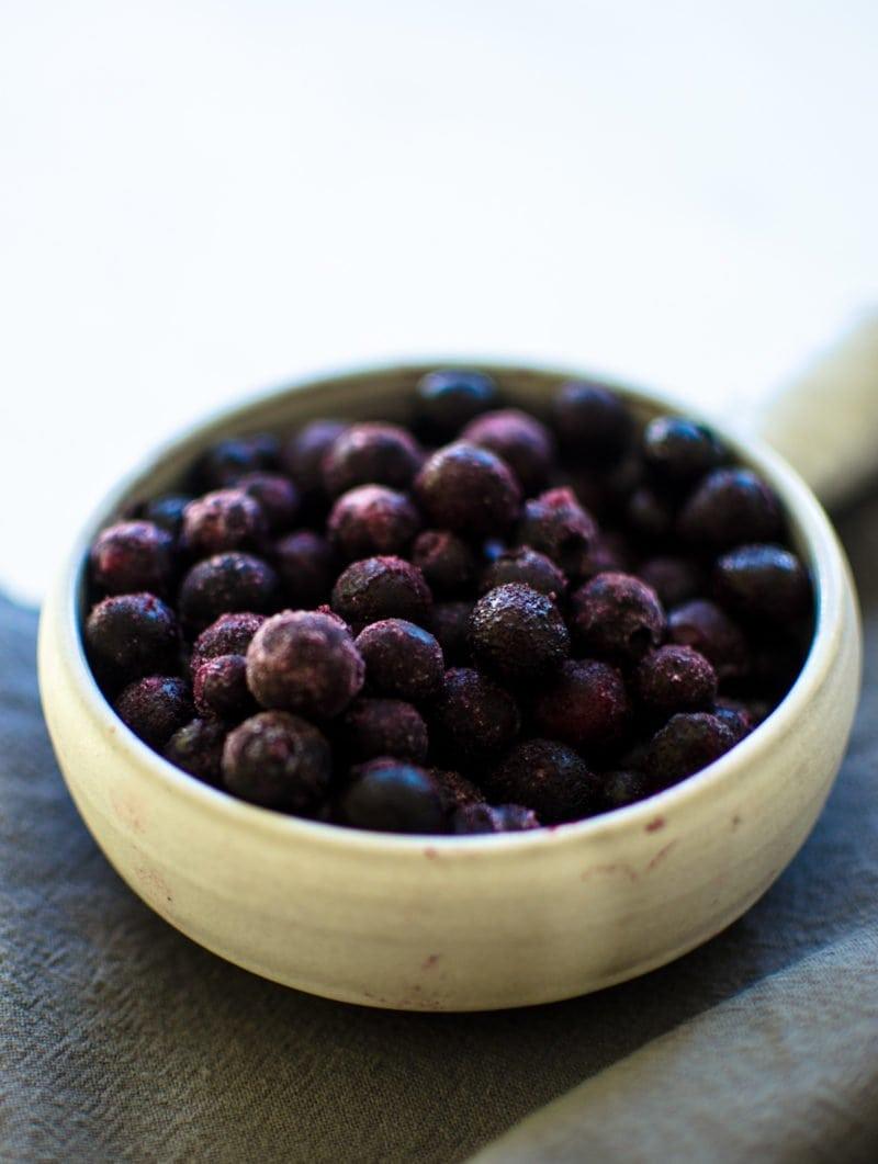 A dish of frozen wild blueberries.