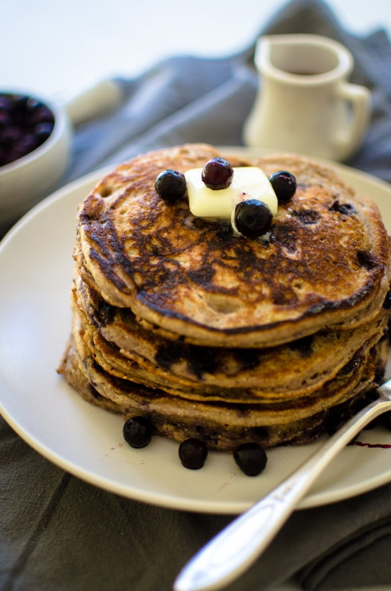 A short stack of wild blueberry pancakes.
