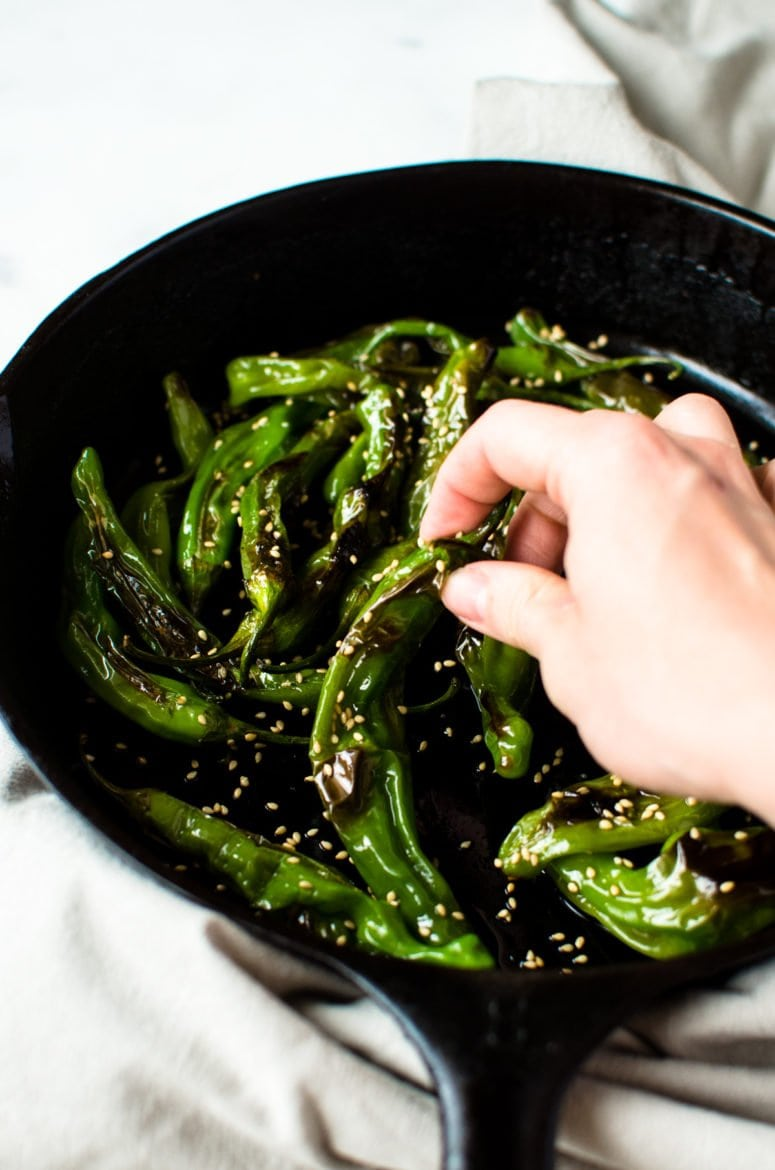 This recipe for Blistered Sesame Shishito Peppers is an easy snack or side dish that you can make in a snap! It's vegan, gluten free, and packed with flavor!