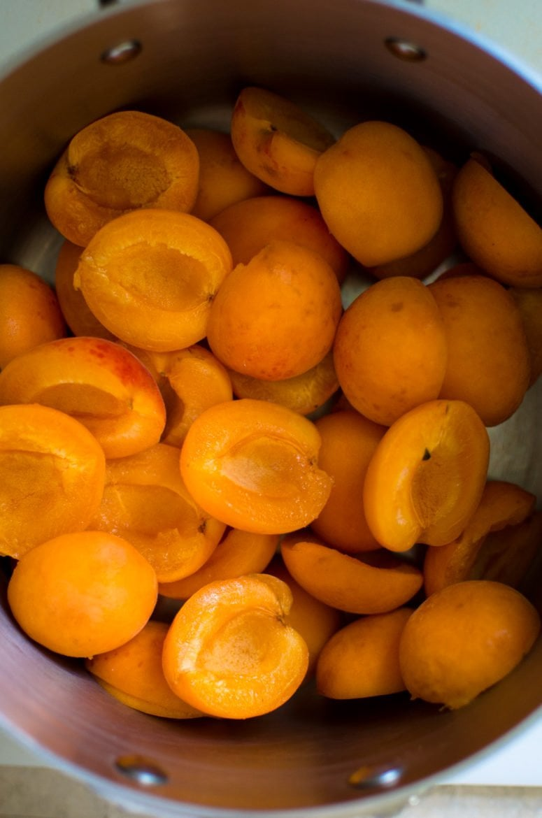 Halved apricots in a pot.