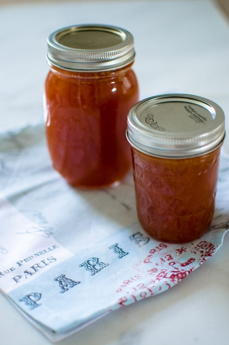 Two mason jars filled with apricot jam
