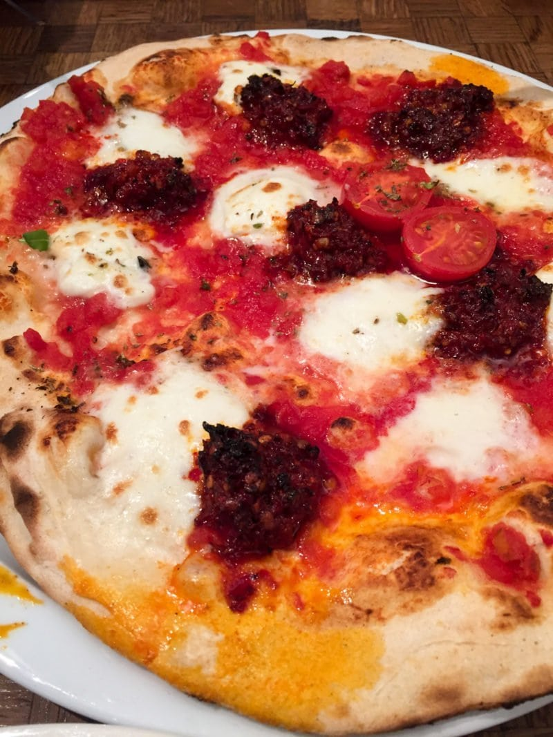 Authentic Neapolitan-style pizza at La Perla restaurant in Amsterdam