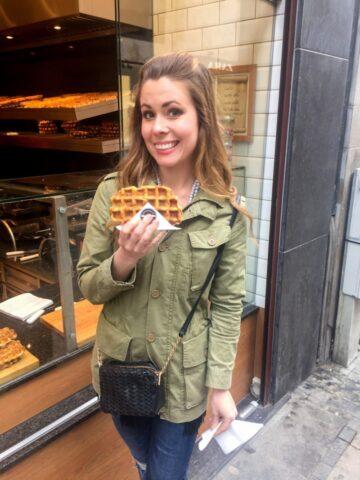 Enjoying a hot Belgian waffle in downtown Brussels, Belgium