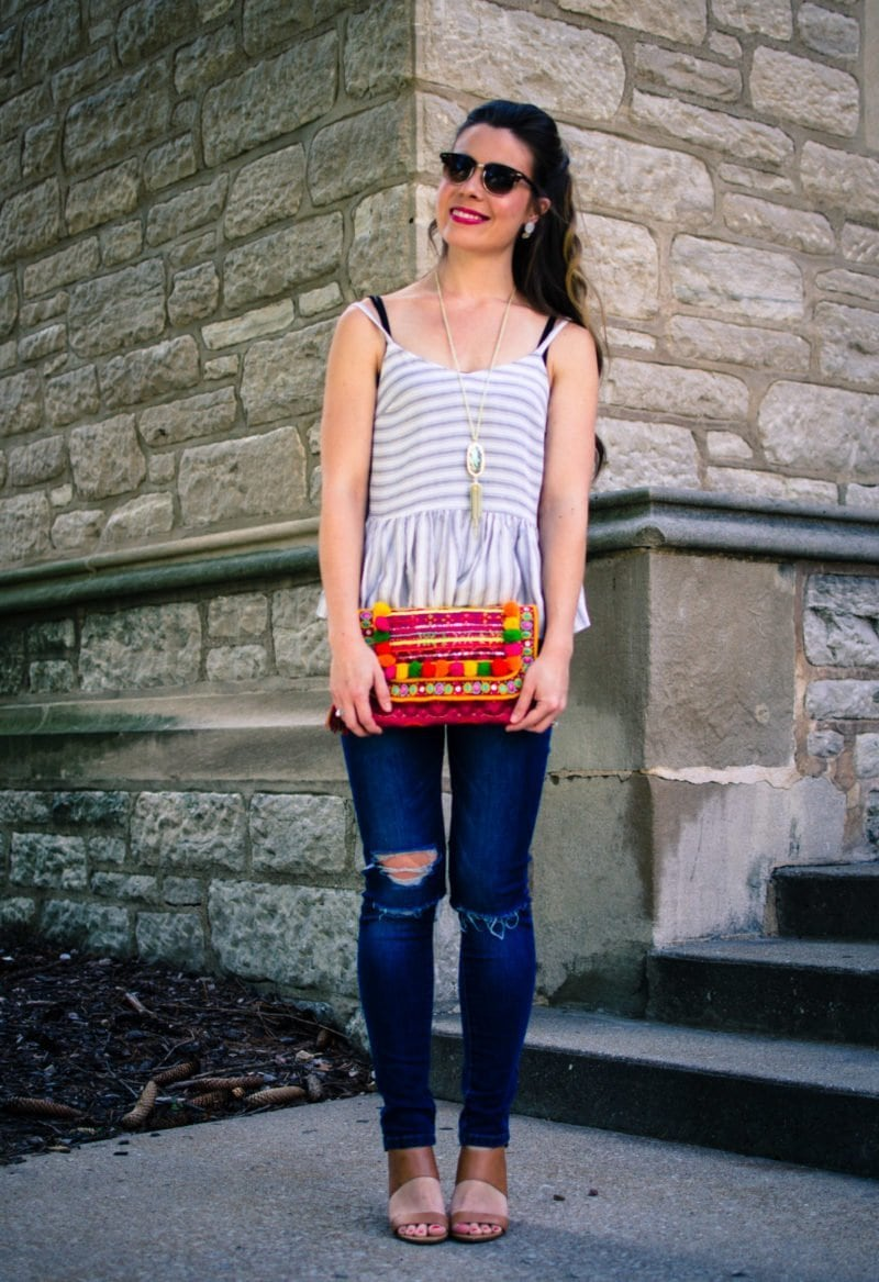 This laid back summer outfit idea feature a soft cotton Asos tank, distressed jeans and a colorful pom pom clutch!