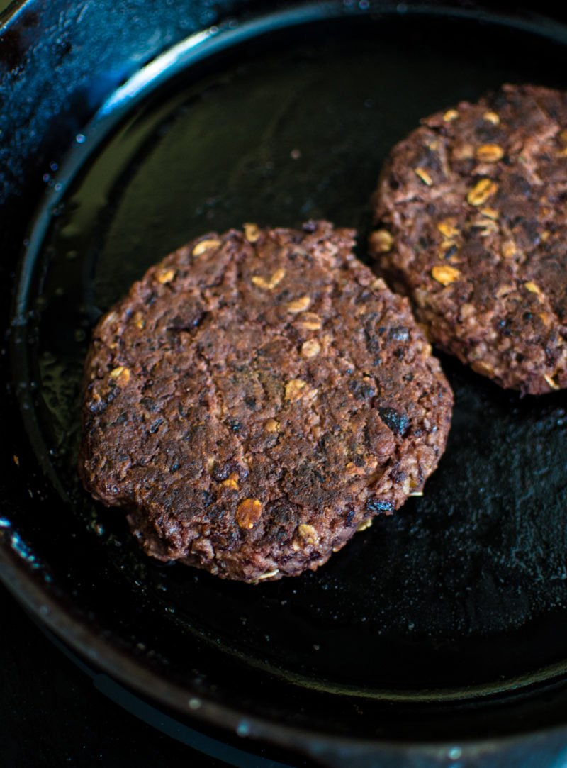 This vegetarian black bean burger recipe is the perfect option for game day. It's smothered in a Hatch chile quest and smoky BBQ sauce.
