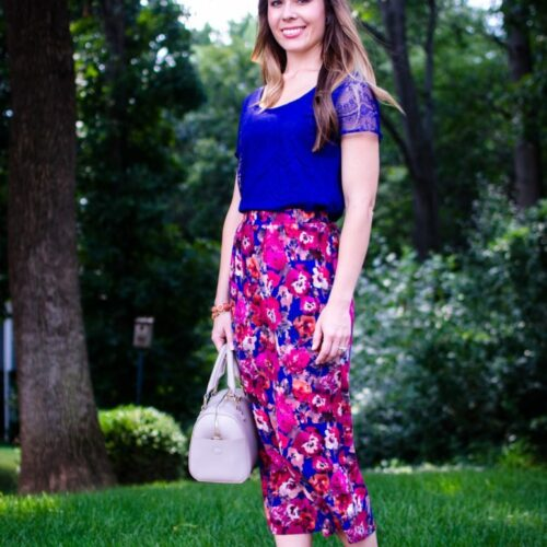 One of my favorite workday outfits is this feminine and colorful combo of a floral midi skirt and lace blouse. Professional workplace style for women.