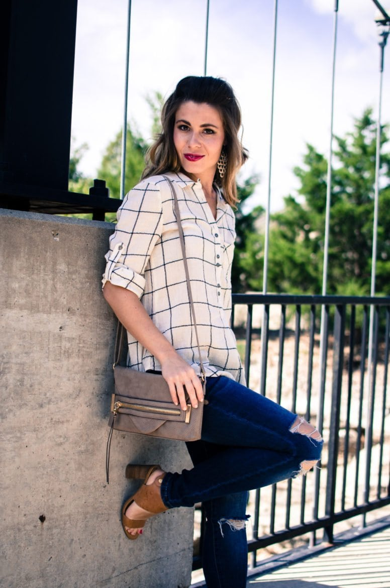 A favorite fall style transition outfit featuring a lightweight plaid tunic top, distressed jeans, and camel-colored sandals.