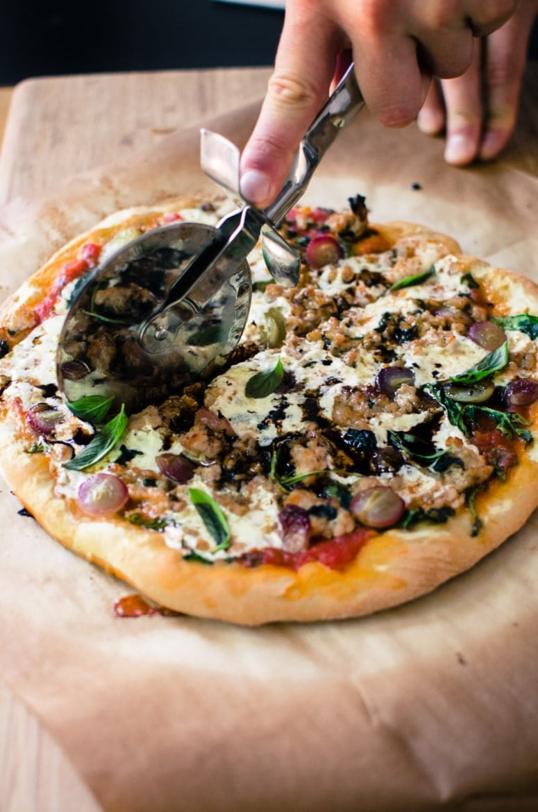 This rustic recipe for Roasted Grape and Chicken Sausage pizza is one of my favorite ways to top pizza during the fall and winter season!