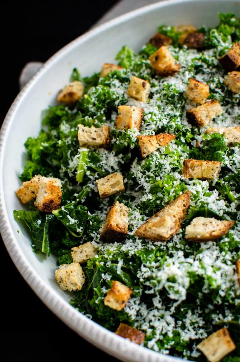 This simple kale salad is the perfect vehicle for creative toppings, homemade croutons, and can be used as a side dish or as sandwich filling!
