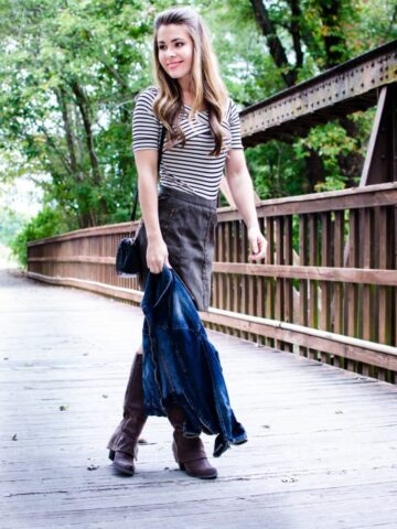 A fun fall weekend outfit is created with a high-waisted suede mini, an off-the shoulder striped body suit, and a denim jacket.