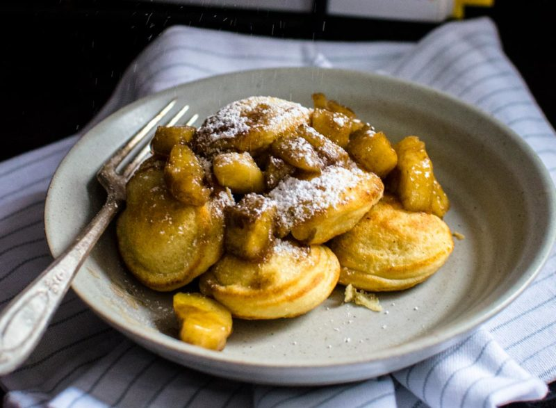 Bananas foster Ebelskivers with powdered sugar.