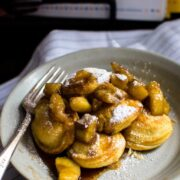 """This recipe for filled pancakes, also known as Ebelskivers, are filled with a butter Bananas Foster compote and are the perfect way to put a little """"hygge"""" into weekend brunch."""