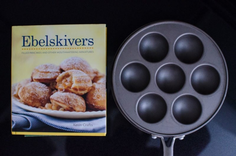 Ebelskivers cookbook next to Ebelskivers pan.