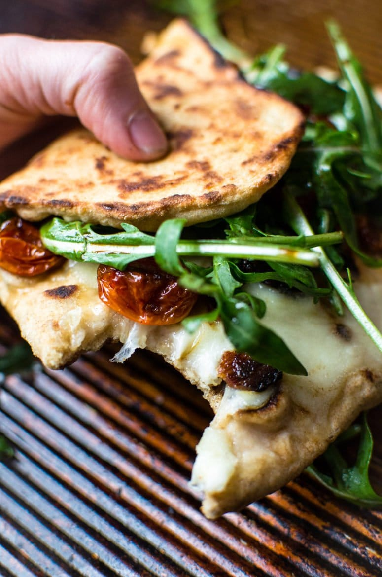 This recipe for BLT Naan Pizza is my favorite way to enjoy a BLT in the winter time! Smokey bacon, sweet roasted tomatoes, and peppery arugula on freshly made naan bread!