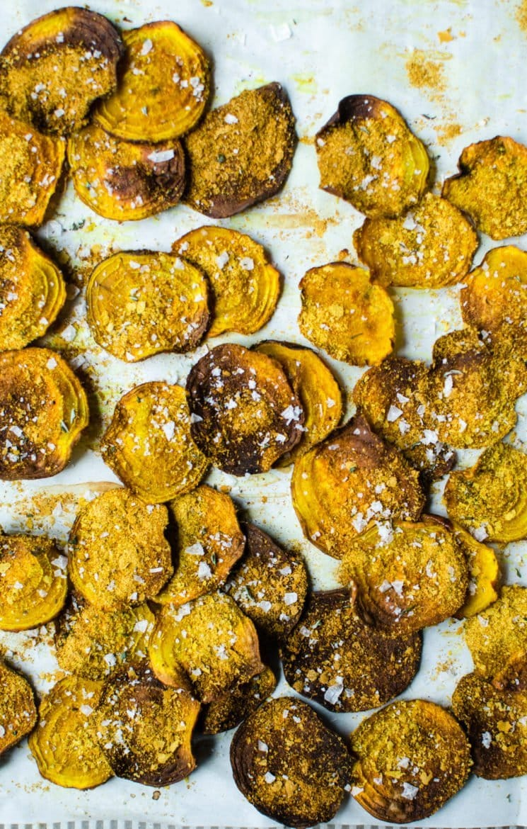 These cheesy golden beet chips with turmeric and rosemary sea salt are a savory +salty alternative to regular chips and are an easy healthy snack recipe! Gluten free and vegan too!
