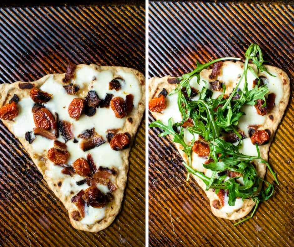 Two slices of pizza. One with arugula on top.