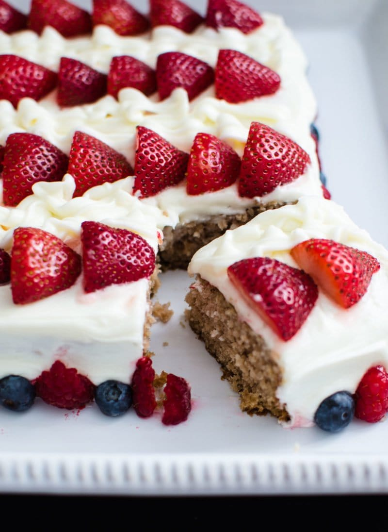 Berry flag cake with a slice cut.