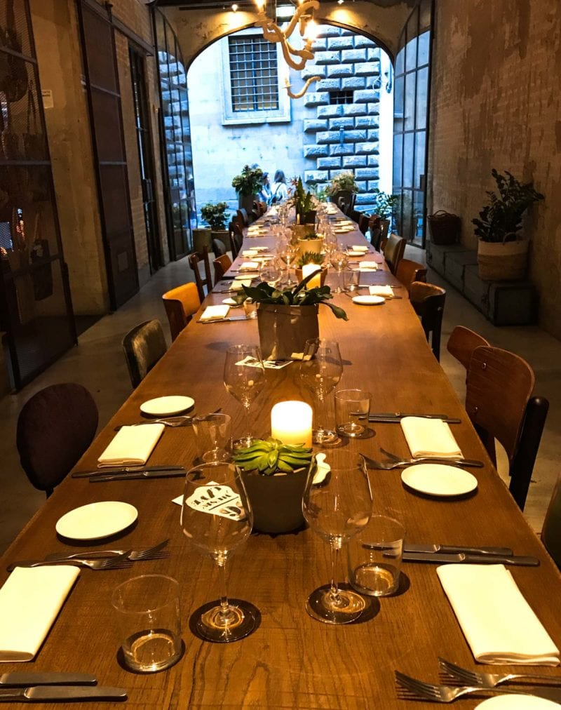 A long table with table settings at each seat in Le Menagere.