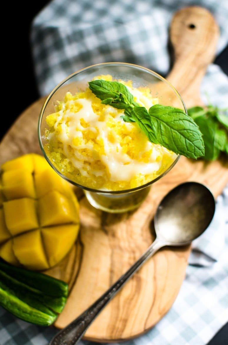 This recipe for summery mango granita is just what the doctor ordered for a hot day - cool, icy and refreshing with a kick from a drizzle of sweet chile milk!