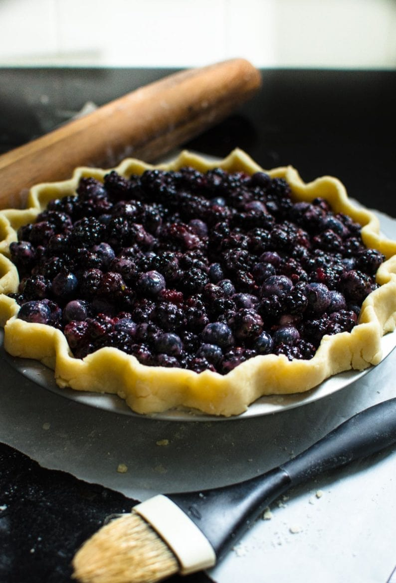 Mixed berry pie in pie dish prior to being put in the oven.