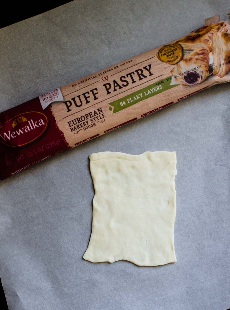 Puff pastry on a parchment paper.