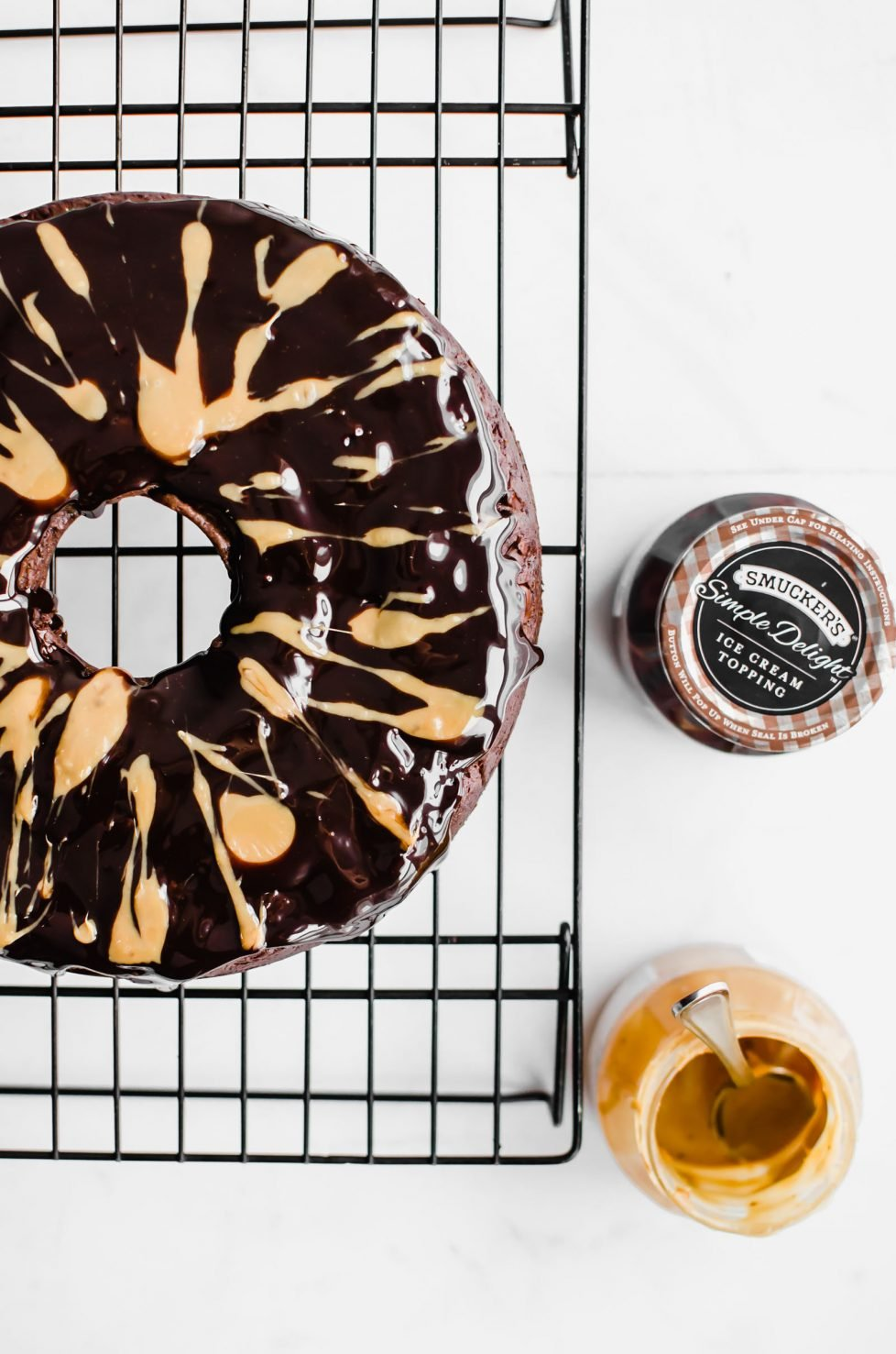 This recipe for Back Pocket Chocolate Fudge Cake is an easy bundt cake that is super moist, fudgy, and extra delicious. It's made with Ghirardelli chocolate, sour cream, and topped with hot fudge and caramel! #valentines #chocolatecake