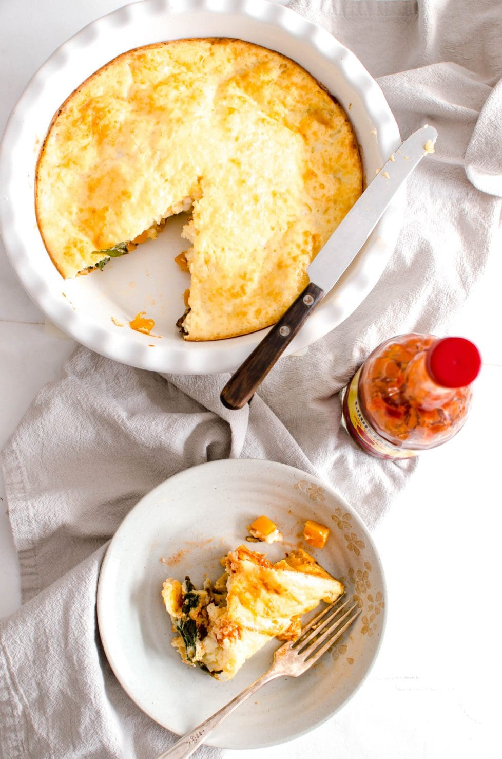 This recipe for Crustless Winter Veggie Quiche is a healthy, lightened up version of a breakfast and brunch favorite. It's filled with winter veggies and can be modified to suit your tastes!